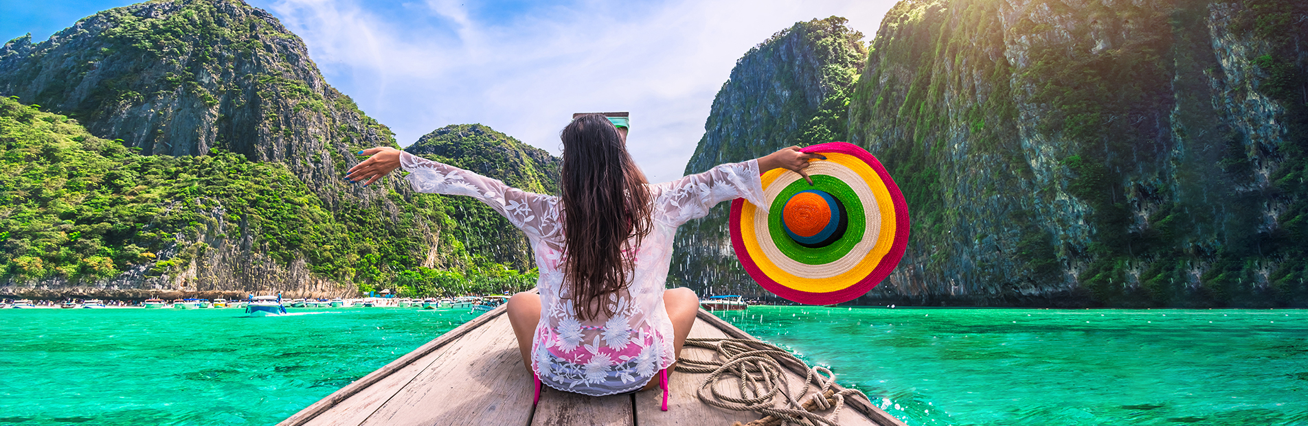 Happy tourist on a long tail boat in Phuket Thailand