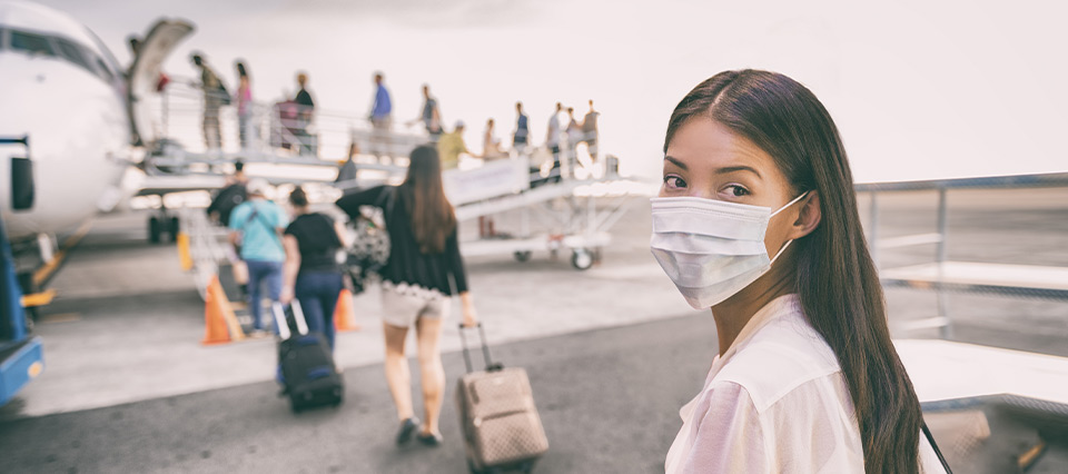 Lady boarding plane wearing face mask