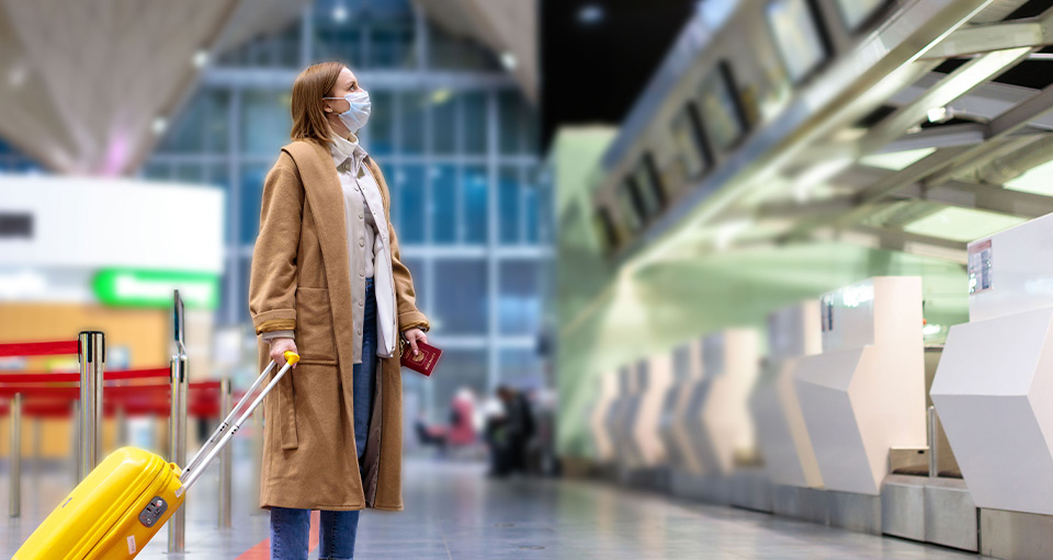 Woman wearing face mask in airport