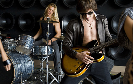 Young musicians playing guitar and drums