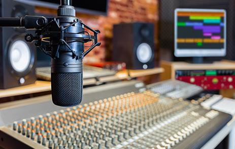 Microphone and mix decks in recording studio