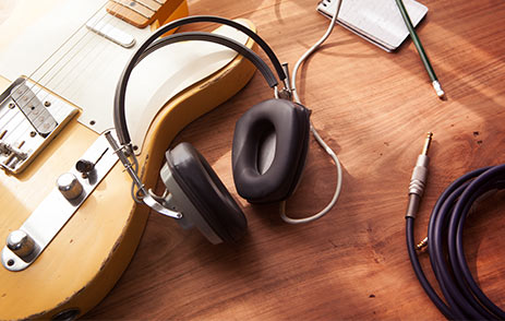 Headphones on table with recording equipment