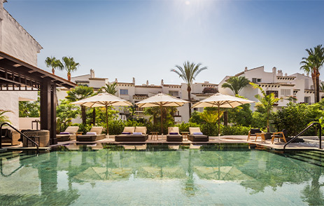 Pool and luxury loungers at Nobu Marbella