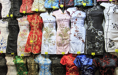 Clothes lined up in a Hong Kong shopping market